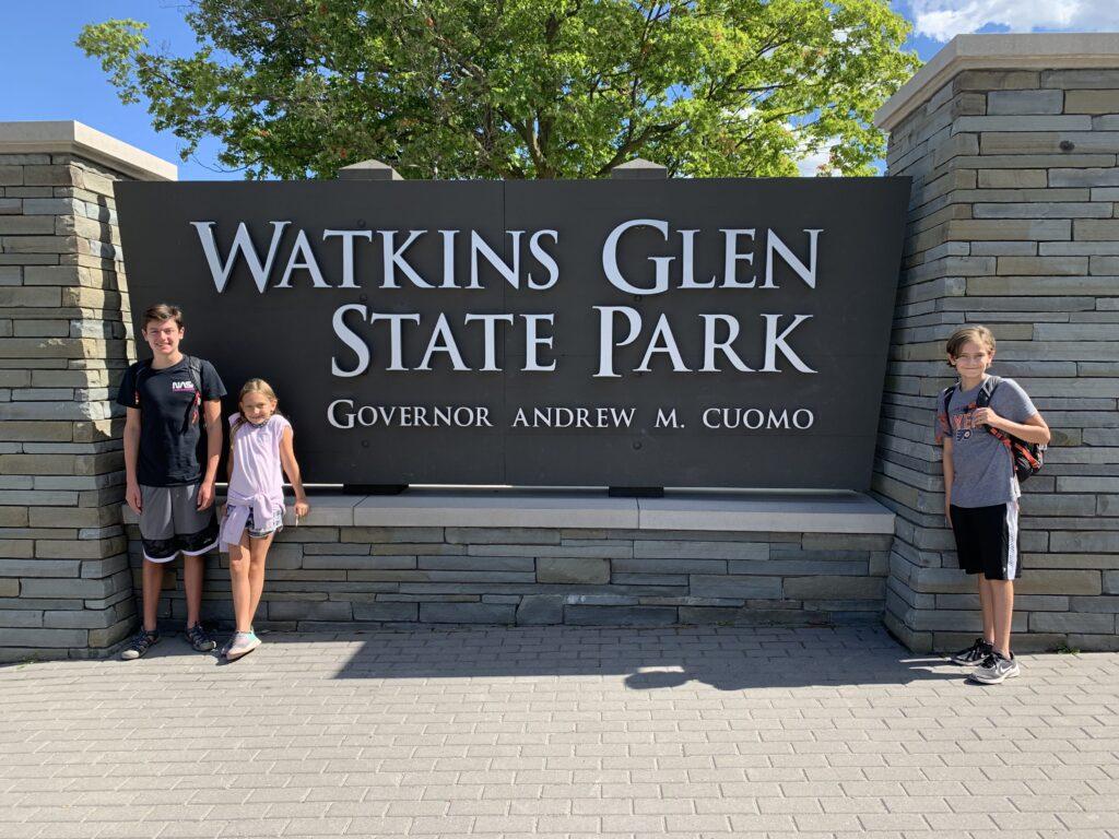 Kids at the Watkins Glen State Park sign