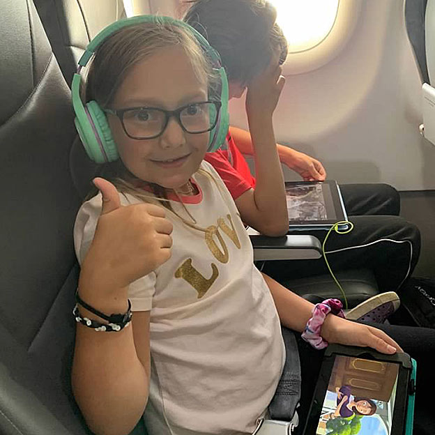 kids flying on frontier airplane