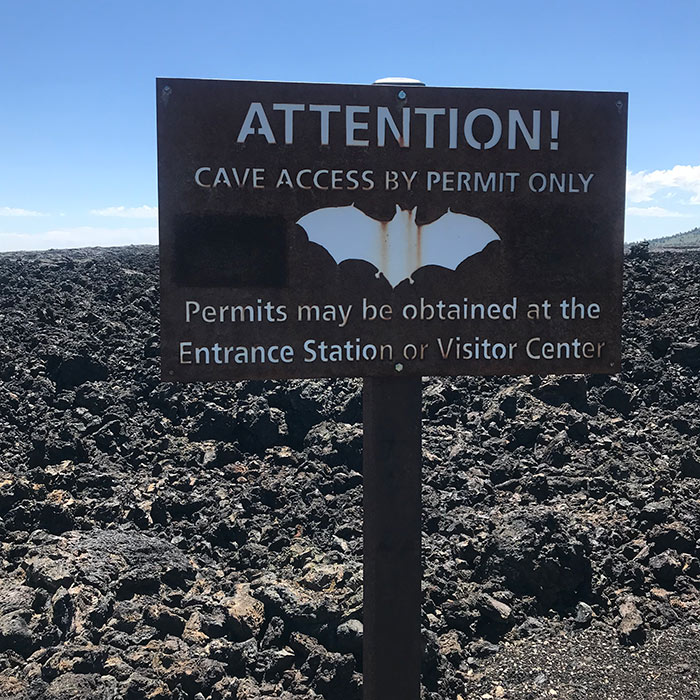 craters of the moon bat cave sign