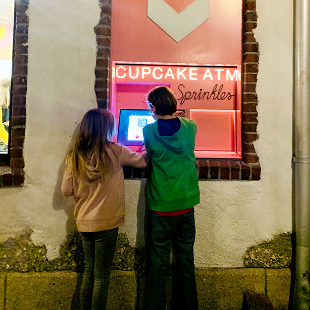 Checking out the Sprinkles Cupcake ATM in Disney Springs