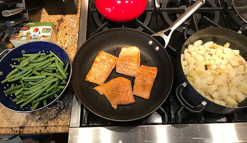 home chef cooking salmon dinner