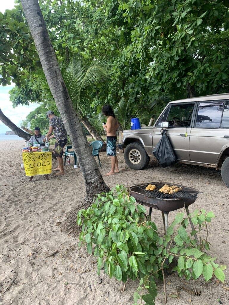 Ticos grilling food on the beach